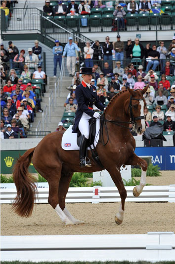 Britain's Laura Bechtolsheimer (25) has pulled off a hat-trick of silver medals by taking second spot at tonight's Dressage showcase event, the Grand Prix Freestyle at the Alltech FEI World Equestrian Games.