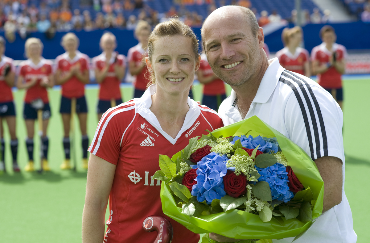 Helen Richardson Walsh receives a bouquet of flowers for her 150th England cap from Performance Director Danny Kerry Eng v Germany EuroHockey.jpg