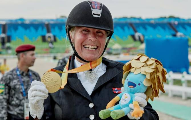 Women sport news - 'It's good to be back,' says Ann Cathrin L�bbe after winning equestrian gold again
