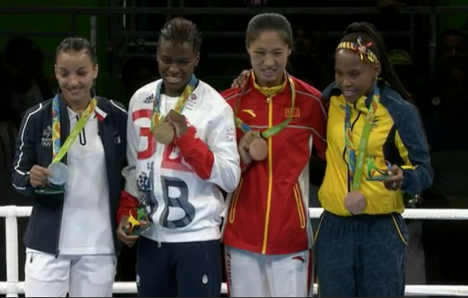 Women sport news - Adams defends boxing Olympic Title