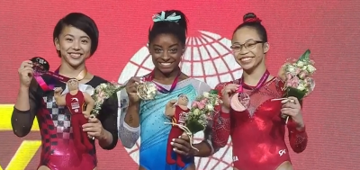 Women sport news - Biles reacts after her victory in the WAG All-around final